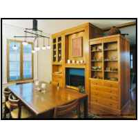 Arts and Crafts kitchen etc.- 4/4 cherry and 3/4 veneer core cherry, inset butt hinged doors with ball catches. single pane glass.  Casework surrounding double faced prefabricated gas fireplace is home china, silverware, serving pieces, etc on the dining room side. Pulls are pyramidal. Low voltage halogen lighting as accent lighting in surround.