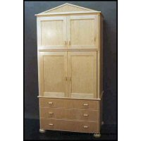 Hard white maple Armoire designed to hold clients a/v gear- central pocket doors, bun feet, and drawers sized to hold audio cassette, video cassette, and compact disks.   Pulls are a proprietary product -the doubled thumb-. 4/4 hard white maple lumber, 3/4 hard white maple veneer core plywood, concealed self-closing hinges. Finished with a clear acrylic resin lacquer.