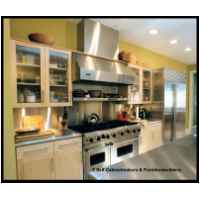 Hard white maple doors with 3/4 thick flat panels in frames. Stainless steel counters, ribbed glass doors, pantry pull out, low voltage halogen lighting