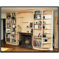 Maple fireplace surround with bookshelves and floating display shelves, features low voltage halogen recessed lighting